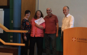 The winning team get their certificate from Peter Phillips